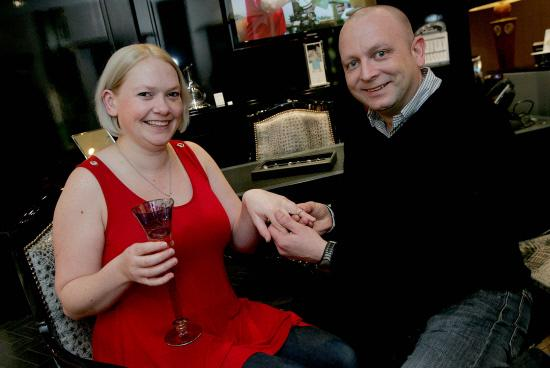 Daniel Claridge and Emily Sara pick a ring at Richard Sinton Jewellers, in Newcastle, following his on-air proposal   Picture: DAVID WOOD