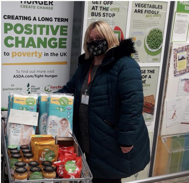 Darlington Support volunteer Carole Fowle collecting donations at Asda