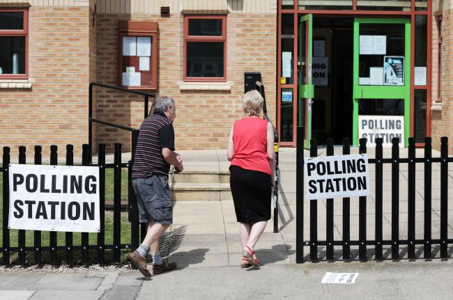 Voters arrive at St. Columba's church polling station in Darlington to cast their vote in the EU referendum. Picture by Stuart Boulton..