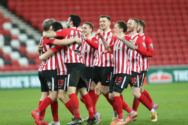 Sunderland's jubilant players congratulate Grant Leadbitter after his successful spot-kick sealed a penalty shoot-out win over Lincoln City in Wednesday's Papa John's Trophy semi-final