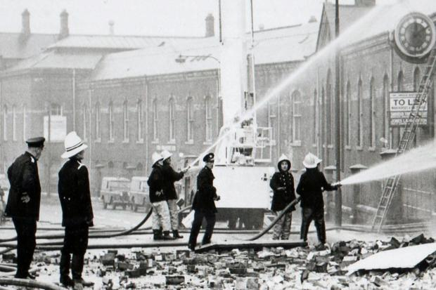 Tackling the blaze in a timber yard in the former North Road railway shops in 1973