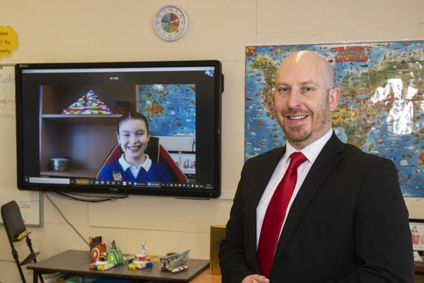 Headteacher Matthew Kelly on Zoom call to student Izzy Stokes