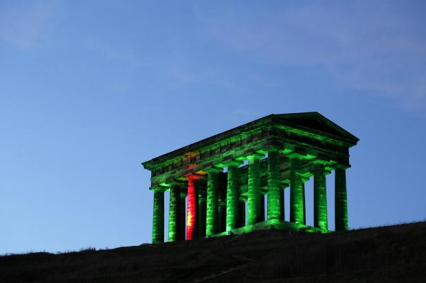 The Northern Echo: The monument is often illuminated mark events or campaigns. Here it is lit in green as part of a National NSPCC campaign Picture: STUART BOULTON