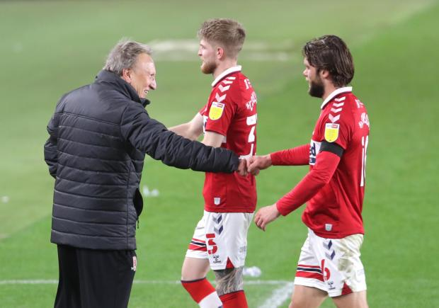 The Northern Echo: Middlesbrough manager Neil Warnock (centre) fist bumps Jonny Howson (right) after the Sky Bet Championship match at the Riverside Stadium, Middlesbrough. PA Photo. Picture date: Saturday October 31, 2020. See PA story SOCCER Middlesbrough. Photo credit sh