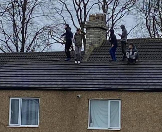 The young men throwing tiles from the roof onto the street below in Bishop Auckland