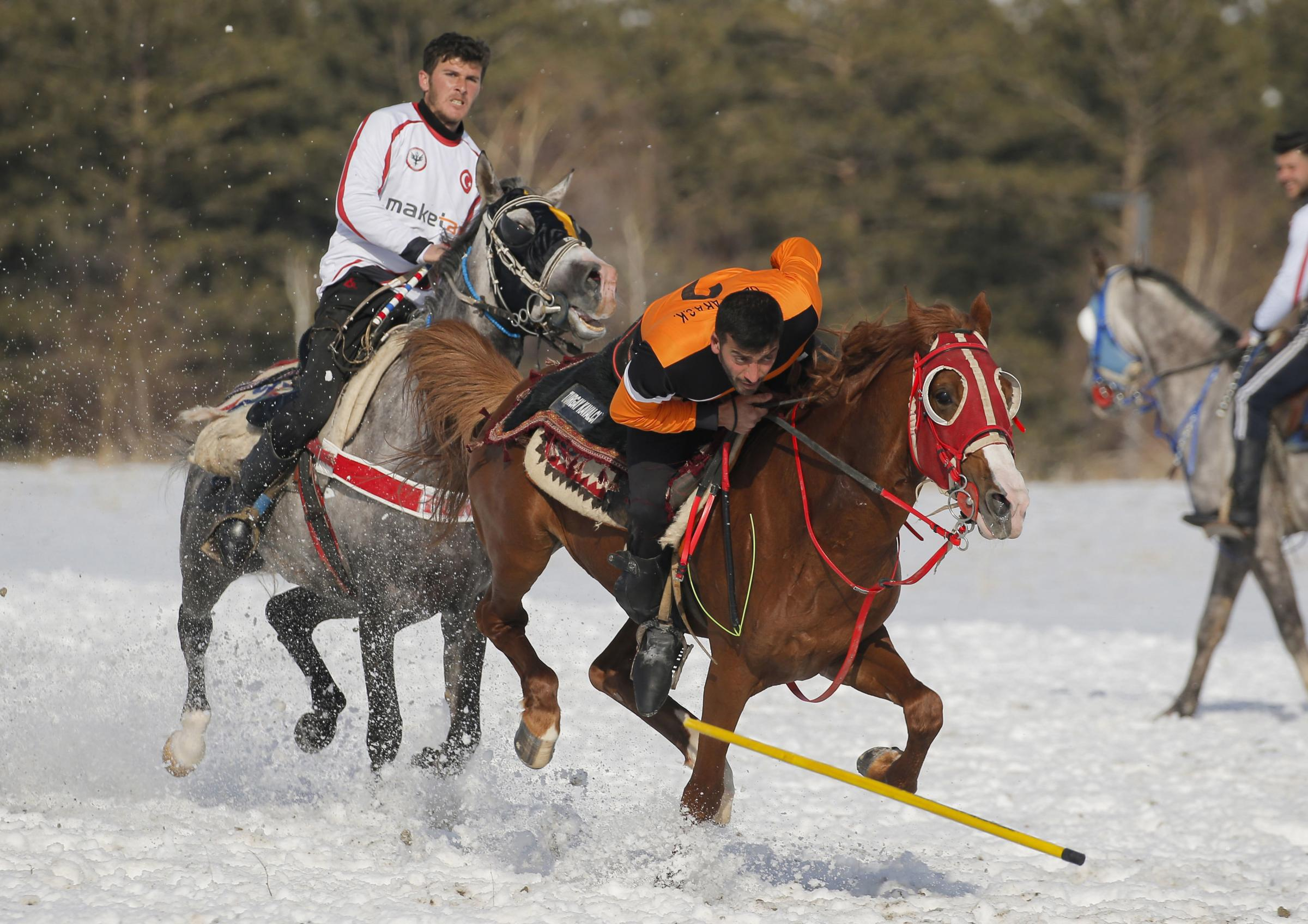 A rider dodges the javelin thrown by an opponent during a game of Cirit, a traditional Turkish equestrian sport that dates back to the martial horsemen who spearheaded the historical conquests of central Asia's Turkic tribes, between the Comrades