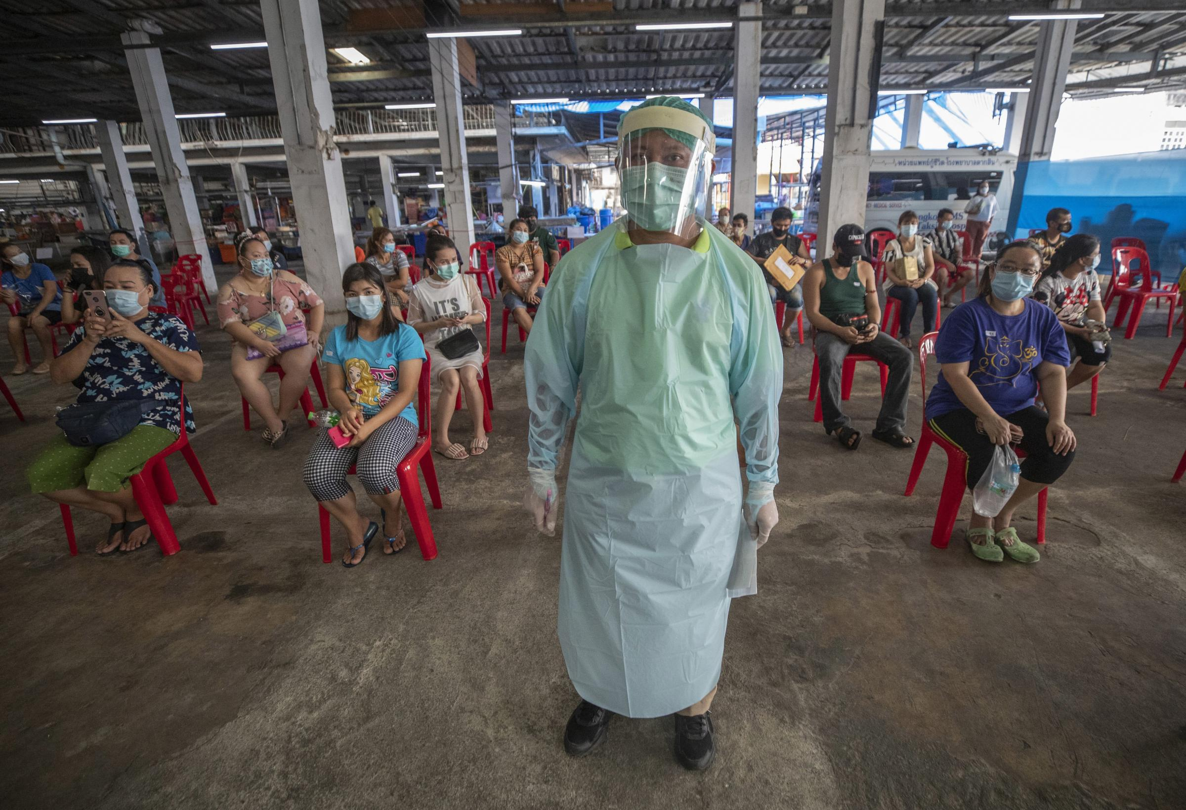 A health worker monitors people who received the Sinovac COVID-19 vaccine for any bad side effects in Bangkok, Thailand Picture: SAKCHAI LALIT/AP