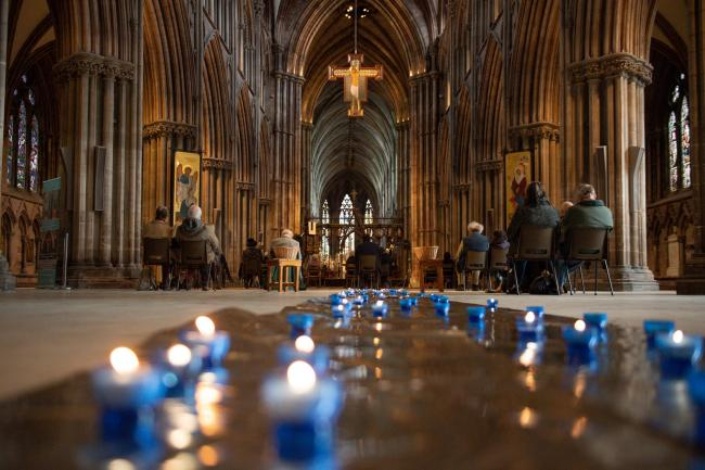 Canon Andrew Stead leads a service during the National Day of Reflection at Lichfield Cathedral, on the anniversary of the first national lockdown to prevent the spread of coronavirus