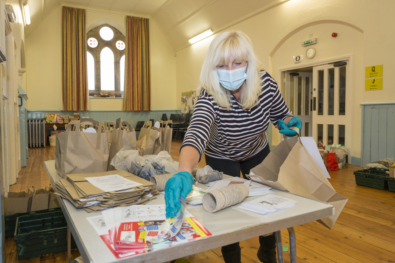 3 June 2020: Volunteers packing children's activity packs, at St Cuthbert's church Hall, Shotley Bridge