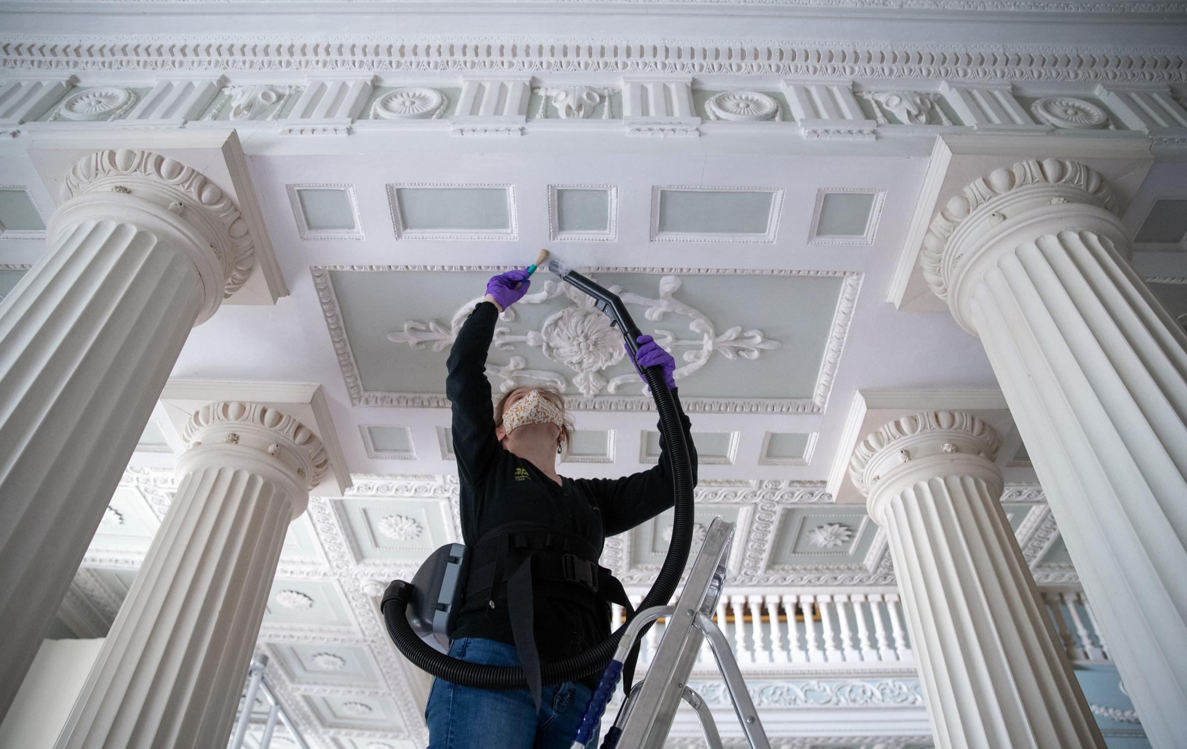 A collections assistant cleans the ceiling of the 18th Century Staircase Hall at the National Trust's The Vyne, a 16th Century estate and country house near to Basingstoke in Hampshire Picture: ANDREW MATTHEWS/PA