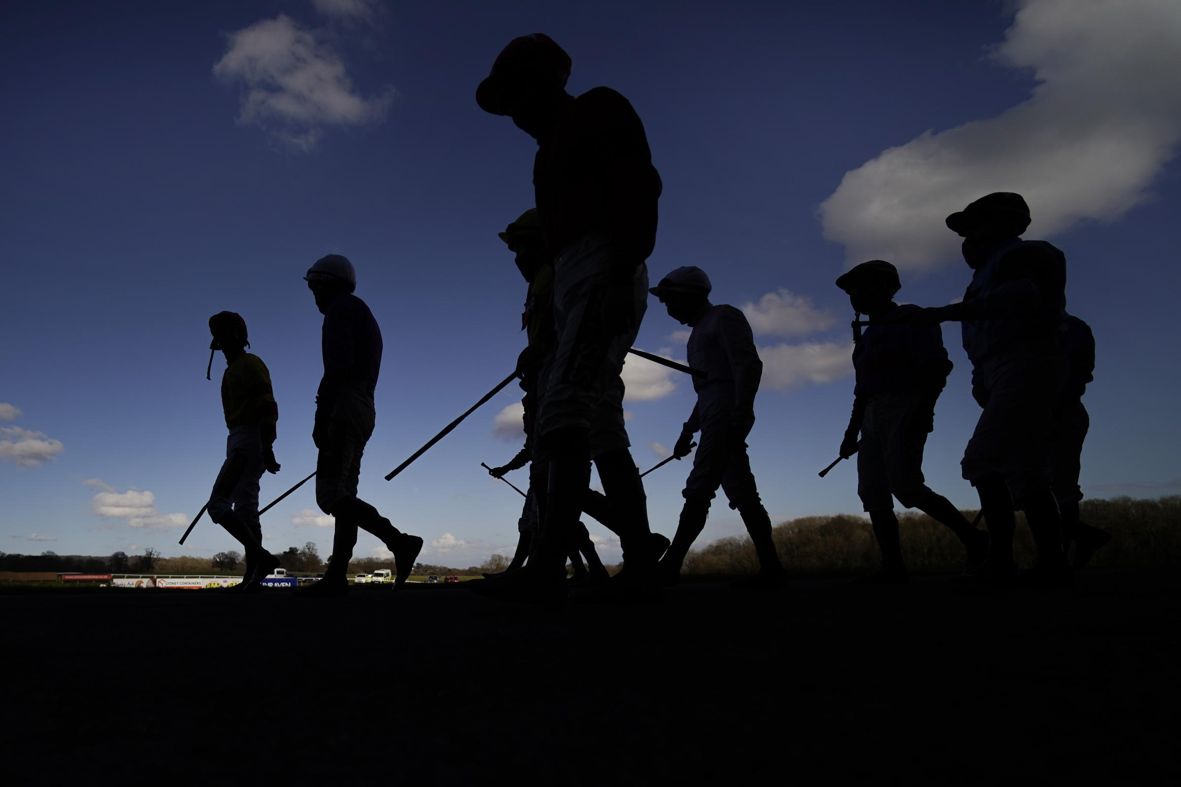 Jockeys make their way to the parade ring at Chepstow Racecourse on Thursday Picture: ALAN CROWHURST/PA