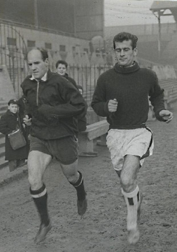 Jimmy Scoular warms up alongside George Luke (right)