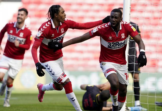 Yannick Bolasie celebrates with Djed Spence after scoring Middlesbrough's equaliser