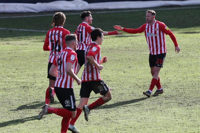 Aiden McGeady celebrates with his team-mates after scoring Sunderland's equaliser at Peterborough on Monday