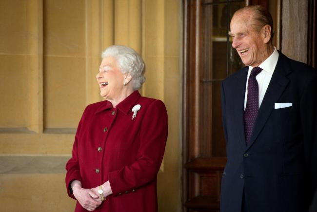FILE Prince Philip, Duke of Edinburgh Admitted To Hospital WINDSOR, ENGLAND - APRIL 11:  Britain's Queen Elizabeth II and Prince Philip, Duke of Edinburgh react as they bid farewell to Irish President Michael D. Higgins and his wife Sabina (not