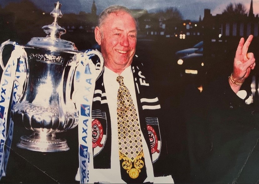 George Reynolds with the FA Cup after Darlington were given a lifeline in the competition in 1999