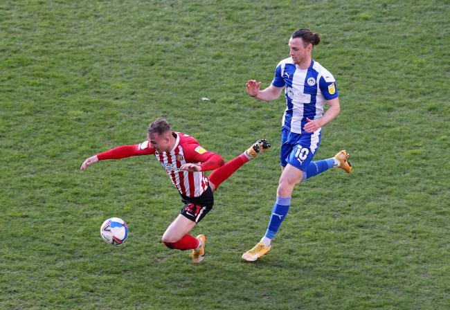 Jack Diamond takes a tumble during Sunderland's defeat at Wigan