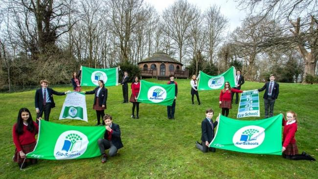 Yarm School pupils with the school's awarded flags