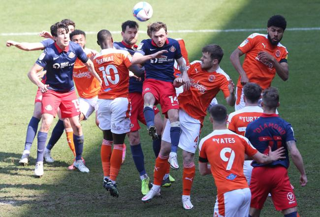 Midfielder Josh Scowen rises up to win a header in a packed penalty area during Sunderland's 1-0 defeat at Blackpool