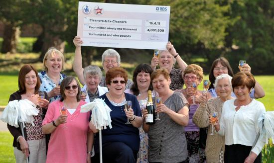 The Northern Echo: Thirteen of the group picking up their Lottery winnings Picture: PAUL KINGSTON / PA