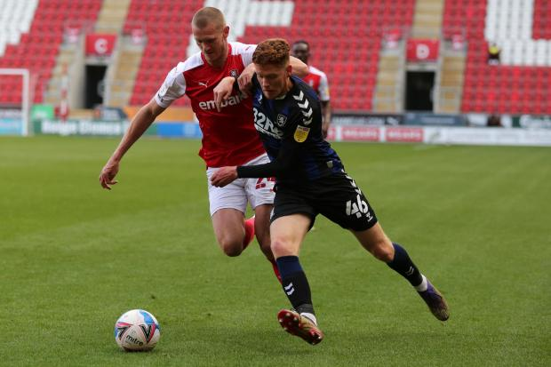 Connor Malley holds off his opponent during his senior Middlesbrough debut at Rotherham