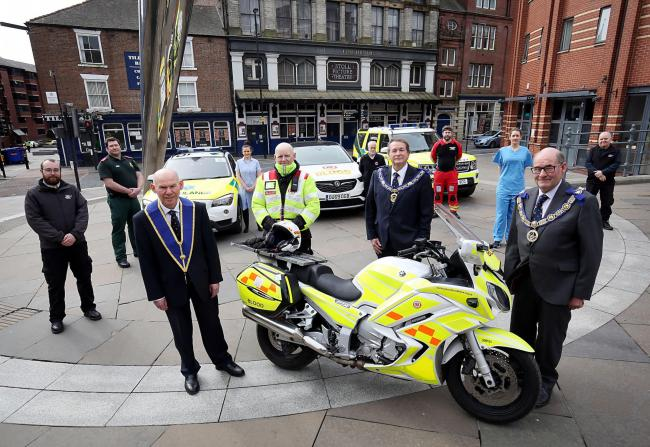 Staff from North-East Ambulance Service, Northumbria Blood Bikes, Great North Air Ambulance with doctors, nurses, Tyne Theatre staff and Freemasons outside the theatre. From left, Freemasons Stuart Cairns, Kevin Stannard, and Ian Craigs   Picture: The
