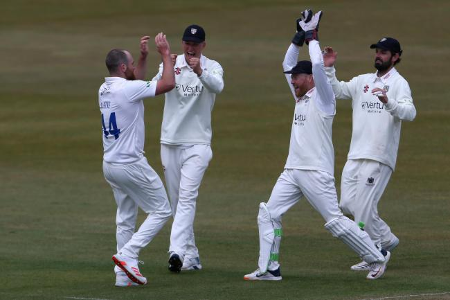 Ben Raine celebrates after claiming a wicket for Durham
