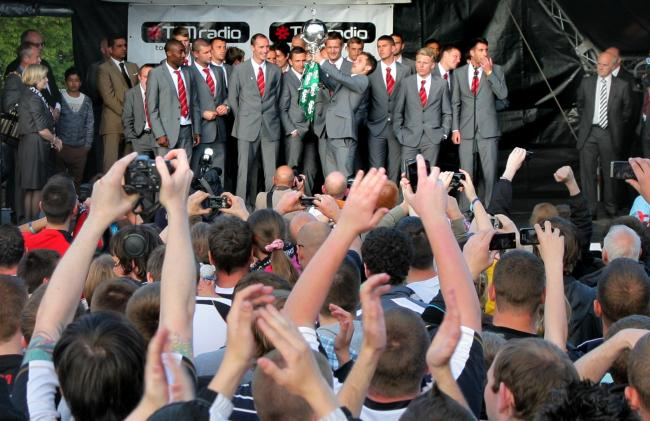 Darlington's players celebrate their FA Trophy win with a civic reception in Darlington Market Place