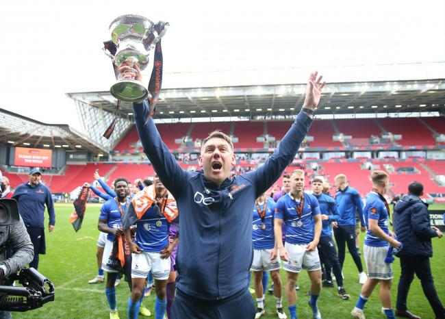 Hartlepool United manager Dave Challinor celebrates with the trophy after winning the shoot-out and promotion after the Vanarama National League play-off final at Ashton Gate, Bristol.