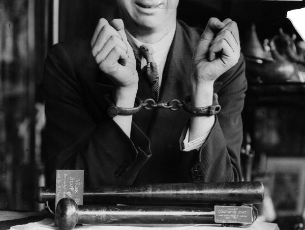 """The Northern Echo: 1890s handcuffs once used at Cockerton. These were presented to the museum along with 19th Century prison manacles and a bobby's 1860s snap cuffs, known as """"comealong cuffs"""", that may have been used by the Stapleton constable. Now in the"""