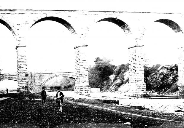 The Northern Echo: A stunning photo, possibly from 1856 and showing the chief engineer of the North Eastern Railway Thomas Harrison standing under his newly opened 11-arch viaduct in Bishop Auckland, which led the railway to Durham via Relly Mill.  In the background is the