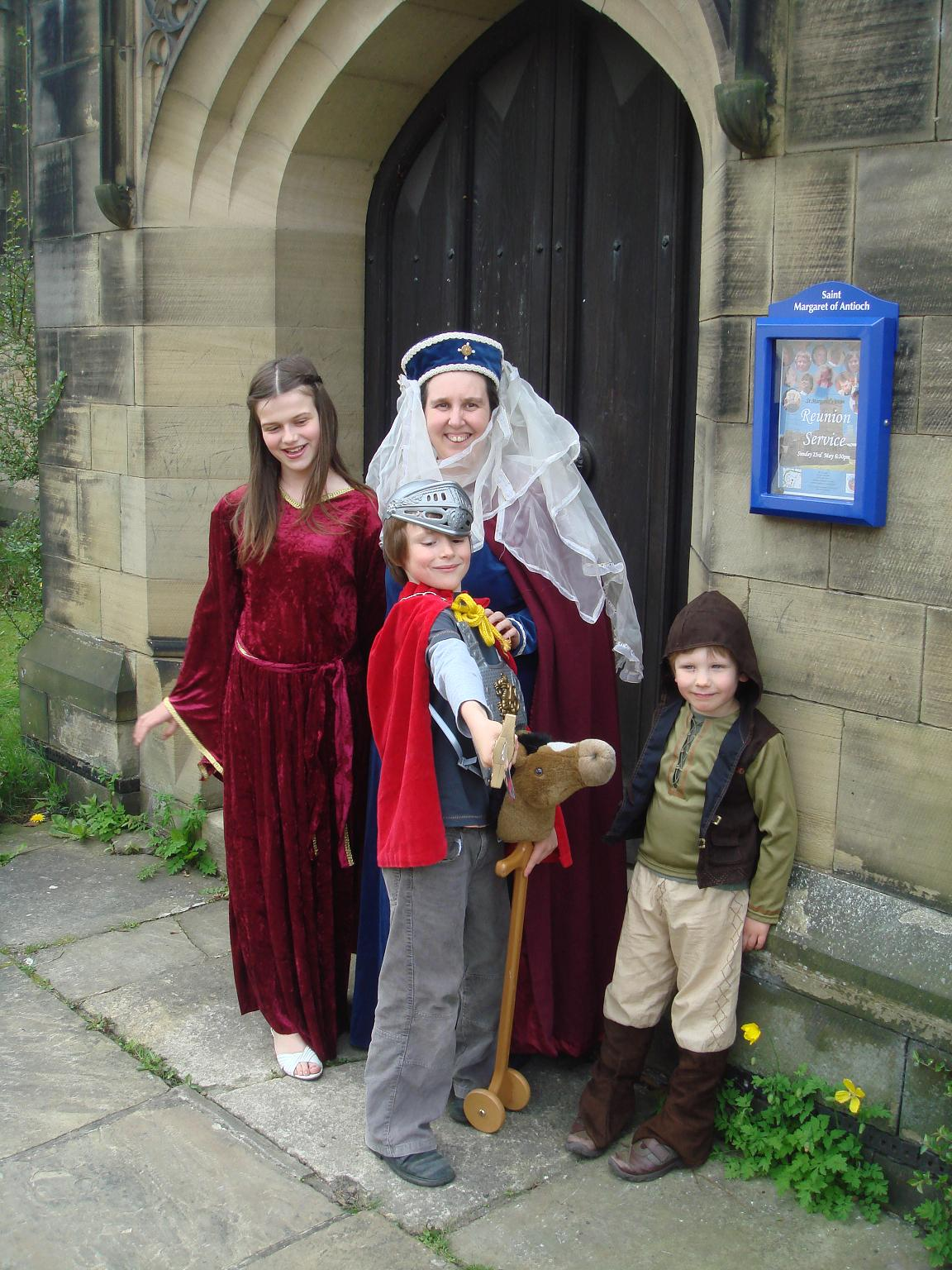 Daniel Lyons as a knight, Elizabeth Harper as a 14th Century noble woman and Emma Lyons and Thomas Moles prepare for St Margaret's Church's medieval fair