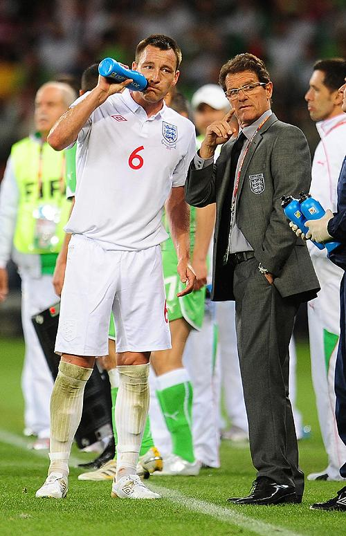STRAINED RELATIONSHIP: Fabio Capello gives John Terry a few pointers in the game against Algeria last Friday