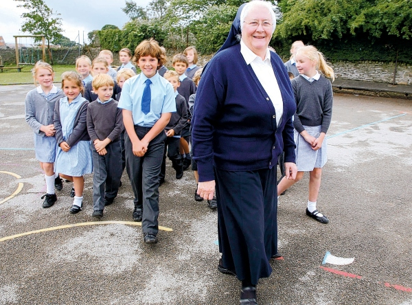 MOVING ON: Sister Anna Ryan with children in the playground
