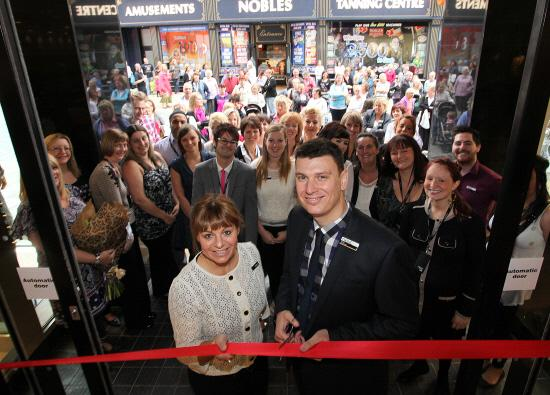 CROWDS GATHER: Michael Jenney and area manager Cathryn Johnstone open the store