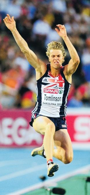 The Northern Echo: LEAPING FOR GLORY: Chris Tomlinson with the jump which won him a bronze medal