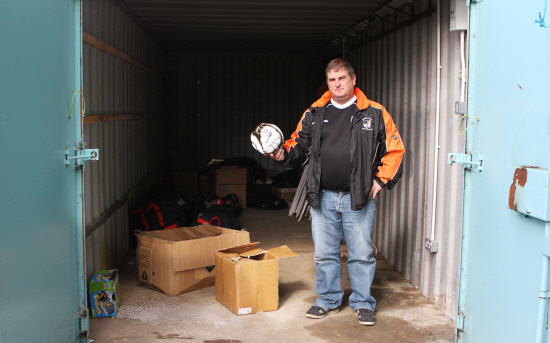 DISMAY: Les Hughes, chairman of Middleton Rangers FC, with the ball left by thieves