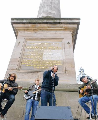 CHARITY SINGLE: The Longsands perform at Grey's Monument, in Newcastle, yesterday. From left, Dave Stanyer, Gary Ormston, Trevor Cox and Ian Barnes