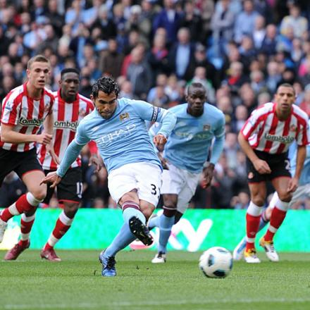 ON THE SPOT: City's Carlos Tevez scores his team's second goal from the penalty spot during yesterday's 5-0 win over Sunderland.