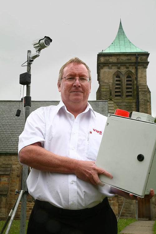 CRIME BATTLE: Colin Chambers with his Vipa UK security system designed to protect churches from lead thieves. He is pictured at St Paul's, Spennymoor, which is to use the system.