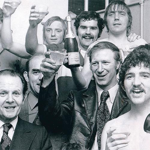 TOAST OF THE TOWN: Jack Charlton celebrates Middlesbrough's promotion with players and staff.