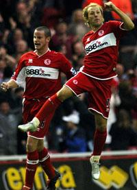 Middlesbrough Gaizka Mendieta leaps into the air as he celebrates scoring in the opening minutes of the match against Manchester United in 2005