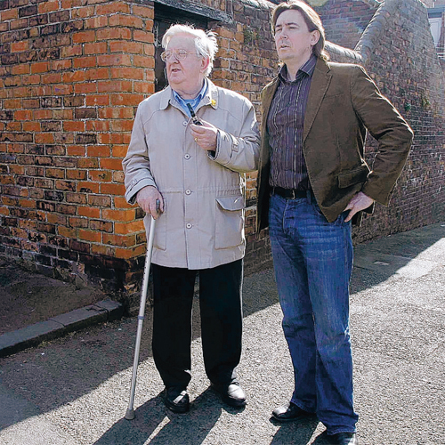 CLOSE ENCOUNTER: Researcher and broadcaster Richard Hall with 76-year-old Robert Hall in the back lane where the pensioners says he was grabbed by an alien in 1940 before his uncle killed it with a shovel.