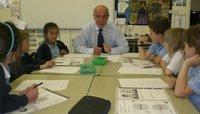 CLOSER WORKING: Keith Taylor, headteacher at Escomb Primary School, near Bishop Auckland, helps children with a project