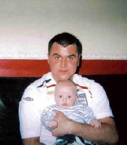Kevin Johnson, who was stabbed to death outside his home in Partick Road, Sunderland on 19 May 2007. He is pictured with his baby