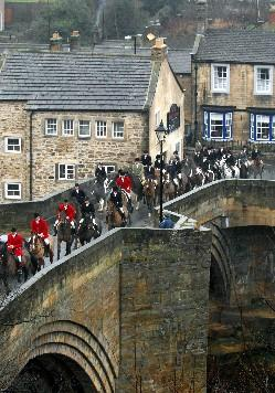 Members of the Zetland Hunt cross the county bridge into Barnard Castle for the start of their traditional New Year's Day hunt