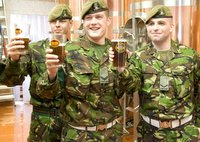 HAILING ALE: Corporals John Cavanagh and Paul Steven, and Lance Corporal Ryan Dunkin toast the brewery's success
