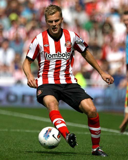 Wenger hails Larsson qualities