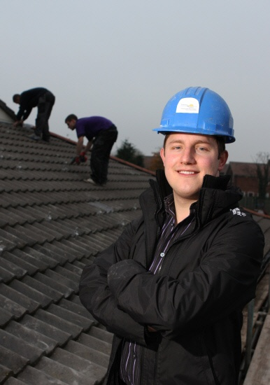 Kevin Nicholson, chairman of Firthmoor Community Association, pictured on the roof at the community centre which is having solar panels fitted.