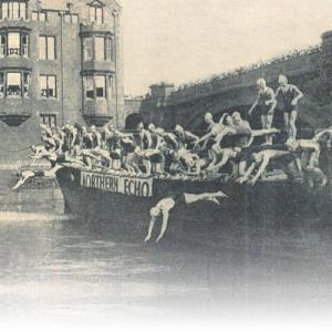 The Northern Echo: Competitors in the Big Swim dive off a barge into the River Tees beneath the Victoria Bridge at Stockton.